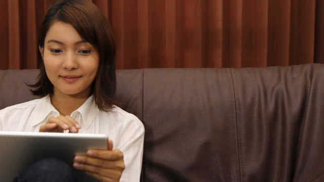 Asian Woman Smiling Looking Up Sofa Front View iPad Store