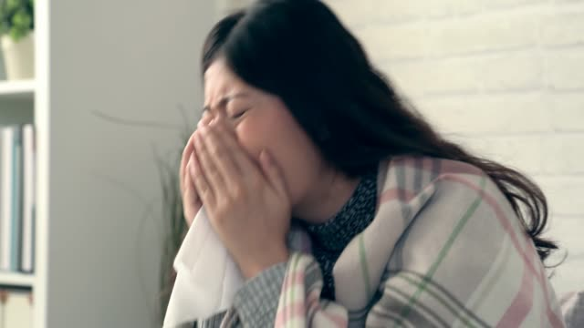 asian woman sneeze and nose itch - flu shot стоковые видео и кадры b-roll