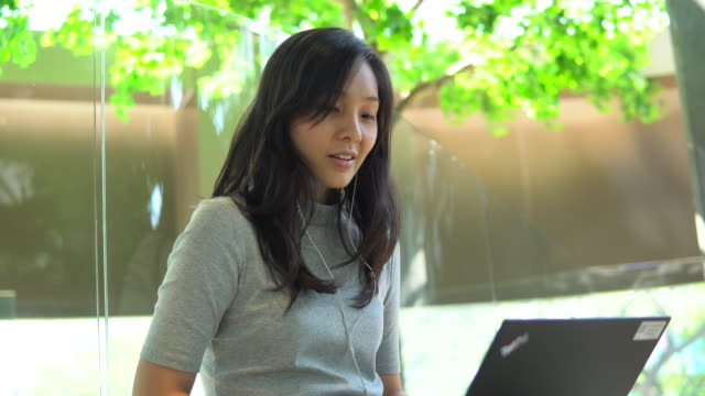 Asian woman student in Library