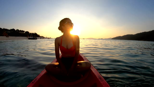 asian woman swims in the kayak in the sunset at lipe, satun, thailand - lakes stock videos and b-roll footage