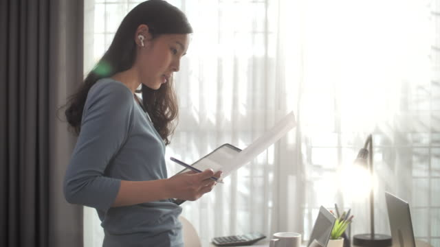 Asian Woman talking with her Customer for Working at home