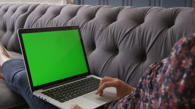 Asian Woman Using Green Screen Laptop At Home Shot On R3D video