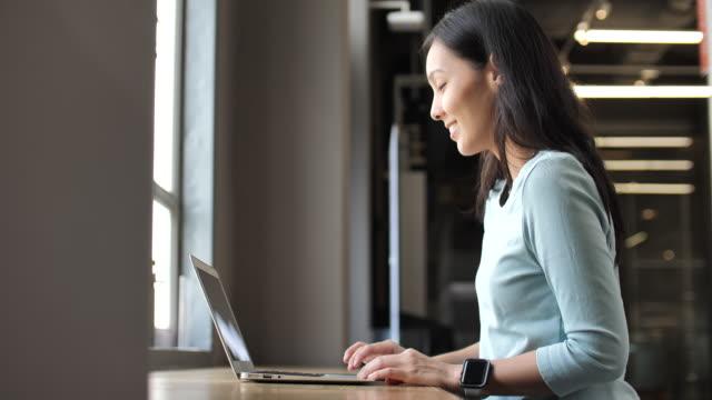 Asian Woman using laptop Computer Asian Woman using laptop Computer e mail stock videos & royalty-free footage
