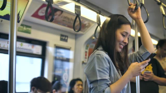 Asian Woman Using phone on Train video