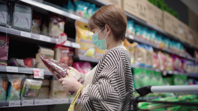 Asian Woman using Pollution mask In Grocery