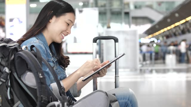 Asian Woman Using Tablet at Airport video