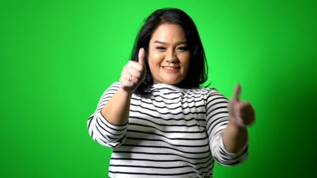 asiatische frau - übergrößen model stock-videos und b-roll-filmmaterial
