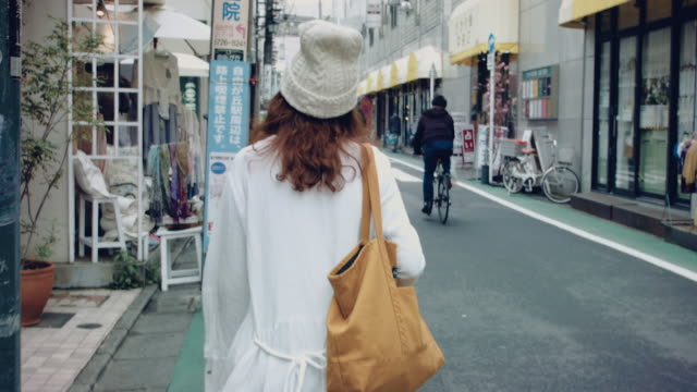 Video Asian woman walking in the local city in Japan.