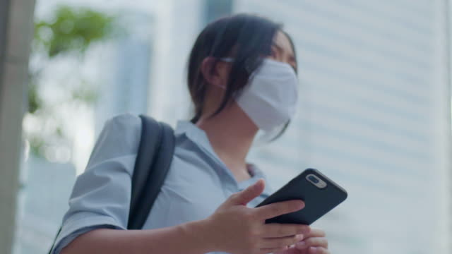 Asian woman wear face mask waiting for uber video