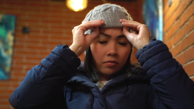 Asian woman wearing winter hat and getting ready to going out