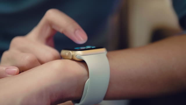asian woman with smart watch on sofa. - computer indossabile video stock e b–roll