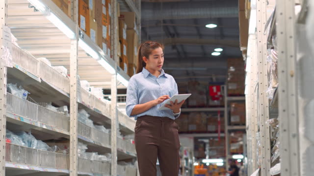 asian woman worker working using tablet checking boxes logistic import and export supplies packages in warehouse , logistics concept - lokalizacja poza usa filmów i materiałów b-roll