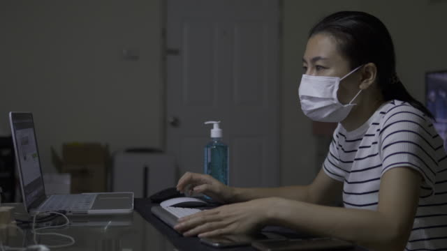 Asian woman working at home