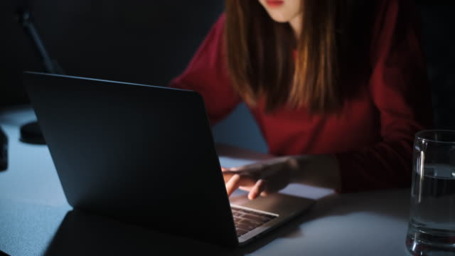 Asian woman working late at night with laptop computer home office looking screen monitor unhappy work hard, Freelancer stay home business quaratine sleepless crisis coronavirus stay home dark room.