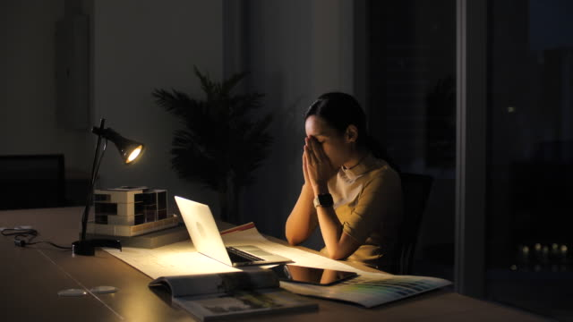 Asian Woman working late into the evening in Office Asian Woman working late into the evening in Office overworked stock videos & royalty-free footage
