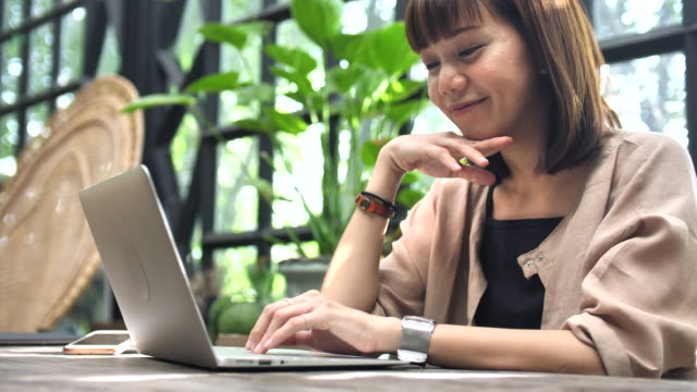 Asian Woman Working with Laptop video