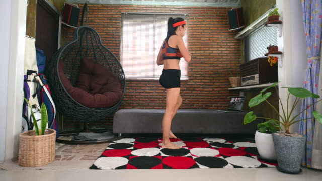 asian woman workout at home
