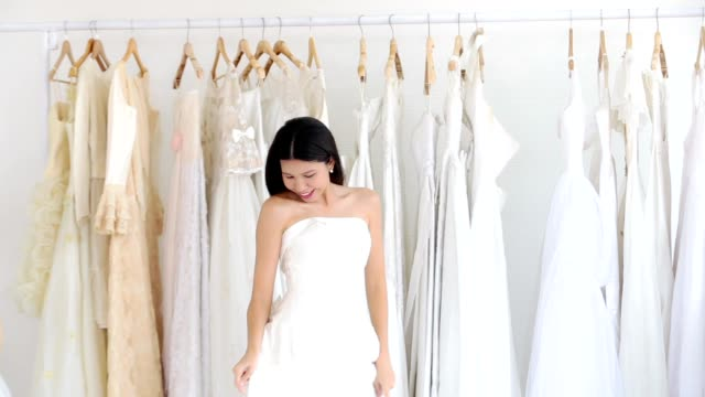 Asian women cheerful happiness in wedding fashion store