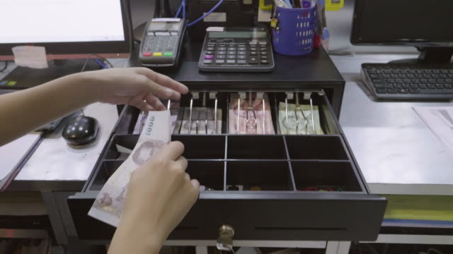 Asian Women Dispensing Change And Counting From A Register Cash Drawer Asian Women Dispensing Change And Counting From A Register Cash Drawer, Dolly Shot, 4K Resolution register stock videos & royalty-free footage