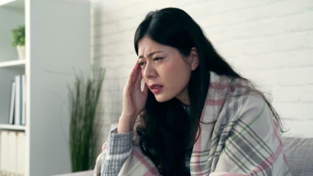 asian women feel extreme headache - flu shot стоковые видео и кадры b-roll