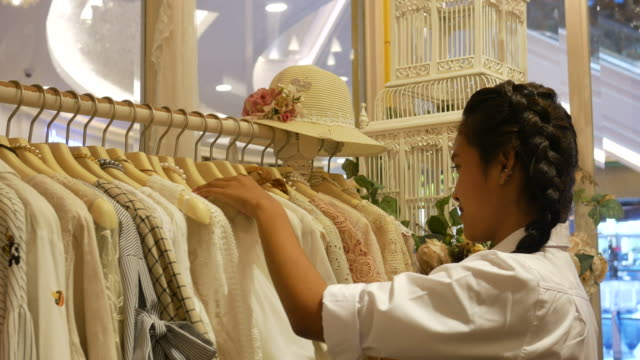 Asian women having fun shopping in boutique video