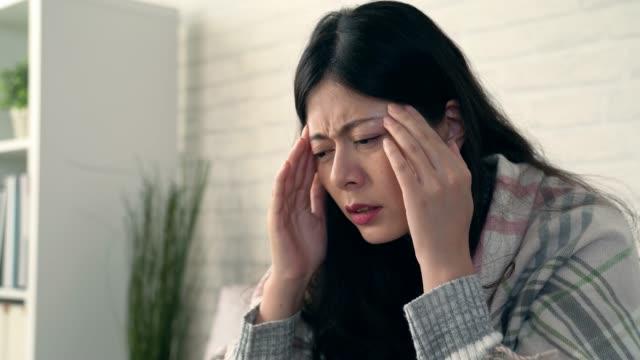 asian women headache because catch cold - flu shot стоковые видео и кадры b-roll