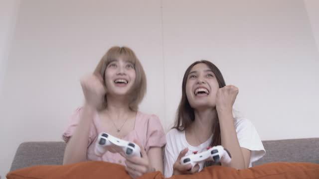 Asian women playing game