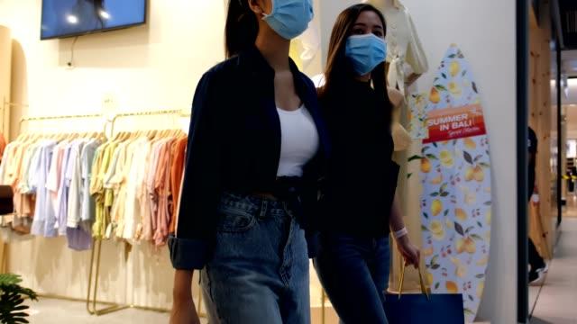 Asian women shopping clothes