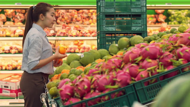 Asian women shopping Healthy food vegetables and fruits in supermarket Asian women shopping Healthy food vegetables and fruits in supermarket snack aisle stock videos & royalty-free footage