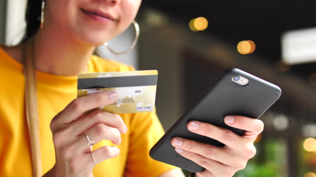 Asian women shopping online with Mobile phone