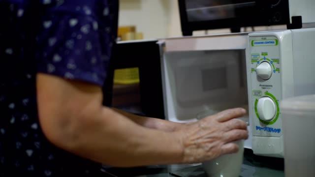 Asian women use microwaves.
