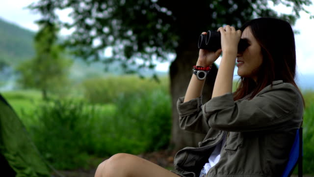 Asian Women using binoculars on the camp site video