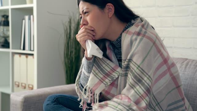 asian women with seasonal allergies - flu shot стоковые видео и кадры b-roll