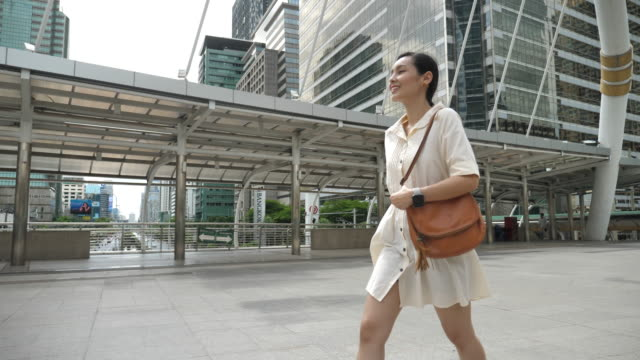 SLOW MOTION Asian Young businesswoman walking