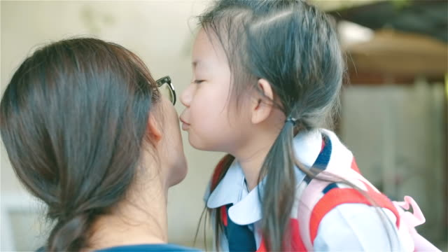 Asian Young mother greeting her daughter after school at house video