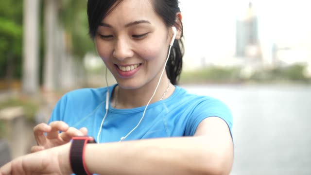 Asian Young Sport woman using Smart watch for fitness tracking