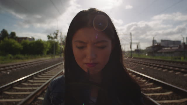 Asian young woman crying on the railway. video