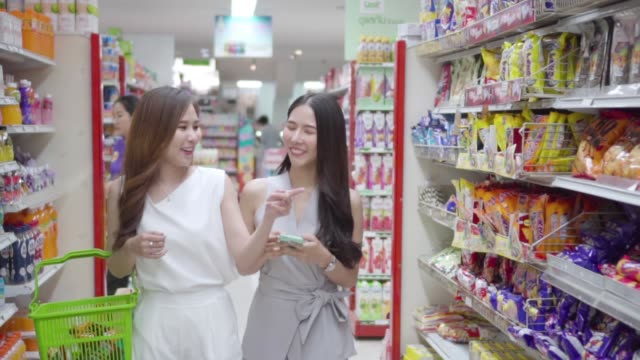 Asian young woman shopping in supermarket, Slow motion. Basket, Thailand, Supermarket, Aisle, Snack snack aisle stock videos & royalty-free footage