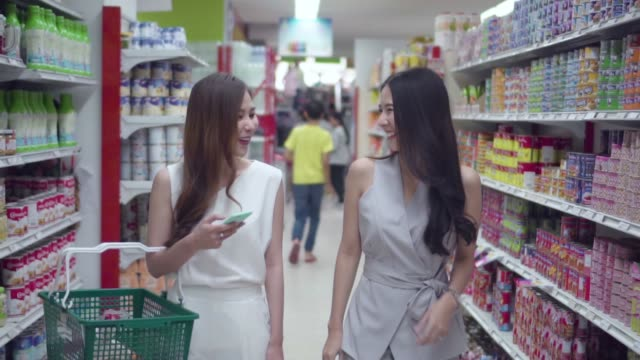 Asian young woman shopping in supermarket, Slow motion.