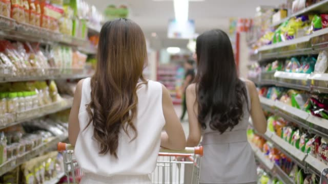 Asian young woman shopping in supermarket, Slow motion. Basket, Thailand, Supermarket, Aisle, Snack snack stock videos & royalty-free footage