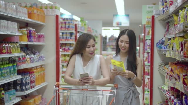 Asian young woman shopping in supermarket Basket, Thailand, Supermarket, Aisle, Snack snack aisle stock videos & royalty-free footage