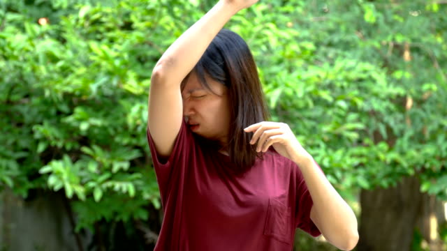 Asian young woman smells her armpits video