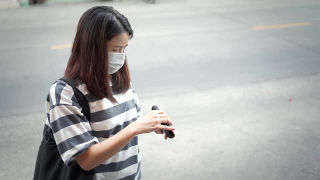 Asian young woman wear mask new normal lifestyle standing take out money pocket, shopping bag,  outdoor shot, covid-19 pandemic crisis, preventing virus, social distancing, financial on edge crisis outdoor shot, NEW NORMAL life concept, wear mask hot pockets stock videos & royalty-free footage
