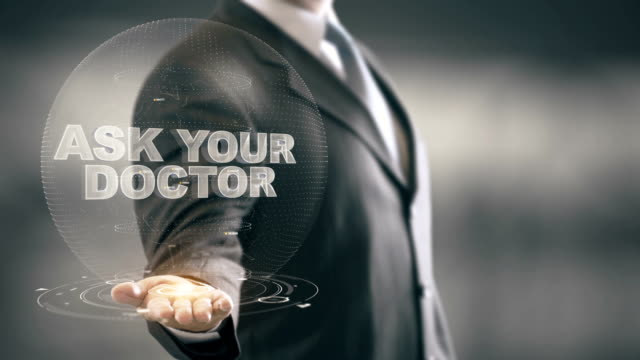 Ask Your Doctor Businessman Holding in Hand New technologies