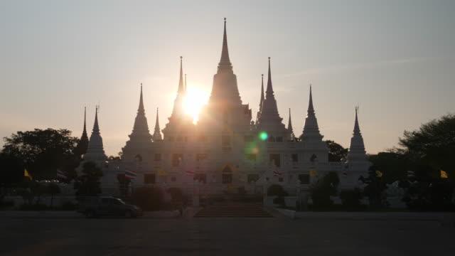 Asokaram Temple with sunset in background, Samutprakarn province Thalland ; zoom out motion