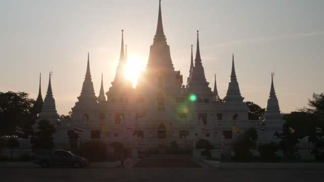 Asokaram Temple with sunset in background, Samutprakarn province Thalland ; zoom in motion