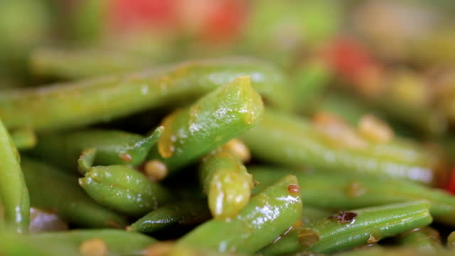 Asparagus beans are fried close-up video