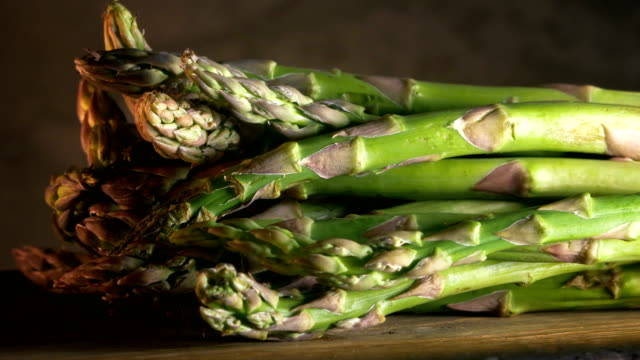 Asparagus on wood, close up video