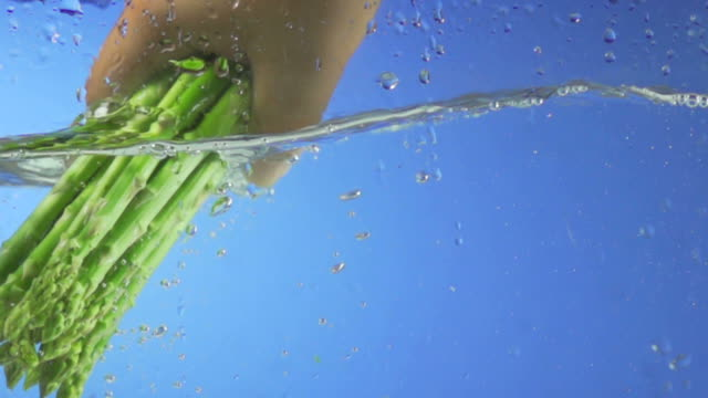 Asparagus Splashing Into Water (Super Slow Motion) video