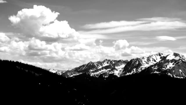 Aspen Colorado Black and white Time-lapse Clouds building over Aspen Highlands Snow Capped Peaks and Deep Elk Mountain Valley video